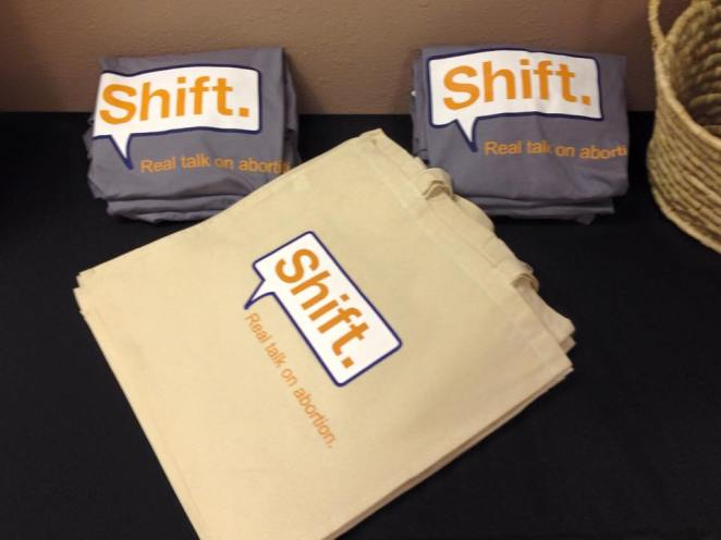 Shift. Real Talk on Abortion. t-shirts and tote bags. Proceeds from these go towards the Whole Woman's Health Stigma Relief Fund!