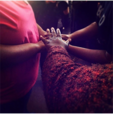 Blessing the hands of our Fort Worth clinic staff.